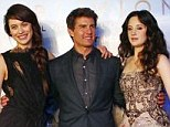 Tom Cruise posed with Ukrainian-born actress Olga Kurylenko and British actress Andrea Riseborough on the red carpet for their film Oblivion in Buenos Aires
