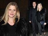 Pregnant Lara Stone styles up her comfy leggings with a black fur jacket for date night with David Walliams
