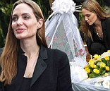 Sombre Angelina Jolie is in a reflective mood as she lays down flowers at memorial to victims of Rwanda genocide