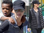 Bubble boy! Sandra Bullock's son shows off new skill as she gives him piggy back ride after school