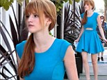 A true Disney princess! Bella Thorne shows off her dancer's legs in flirty blue dress as she hosts afternoon tea party