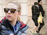 Aren't you cold? Scarlett Johansson bares her legs as she ducks for cover from snowstorm with boyfriend Romain Dauriac
