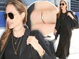 'We are not married!': Angelina Jolie says that she and fiance Brad Pitt did not secretly tie the knot after wearing a gold band on her wedding finger