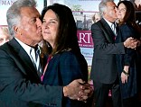 More in love than ever! Dustin Hoffman showers his wife of 32 years with kisses at Paris première