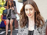 Step to it! Sassy Lily Collins shows off her tiny leather shorts as she puts on a leggy display during an afternoon stroll