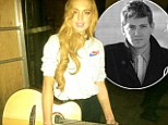 Lindsay Lohan tweeted a picture of herself with a guitar at the City Of The Sun gig featuring boyfriend Avi Snow