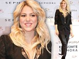 Her hips don't lie! Shakira shows off major cleavage and post-baby curves in leather trousers...less than TWO months after giving birth