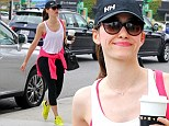 Emmy Rossum picks up a cup of coffee and pays her parking meter before heading into an office building in Brentwood, California
