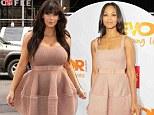 So that's how it's supposed to look! Kim Kardashian's Lanvin dress was worn first by willowy Zoe Saldana