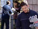 Is that your toy, boy? Tom Hardy gives stuffed dog to Noomi Rapice on set of Animal Rescue in New York
