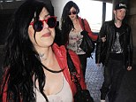 Who cares? Kat Von D looks oblivious to ex Jesse James' marriage as she happily goes through airport with DJ beau deadmau5