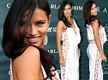 Angel in the Miami heat! Adriana Lima shows off her sideways allure in skin-revealing dress as she walks the red carpet at charity event