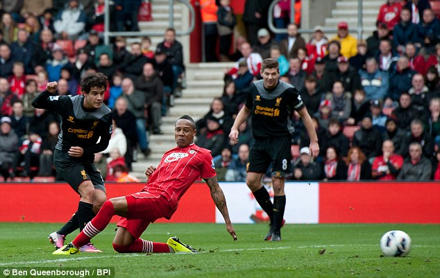Cutting the deficit: Phillipe Coutinho scores on the stroke of half-time for Liverpool