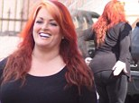 You can't handle this jelly! Wynonna Judd slaps her voluptuous rear end as she prepares for another day of dance practice