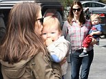 One for the road: Jennifer Garner smooched her son Samuel's forehead as she strapped him into his child safety seat