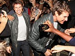 Tom Cruise was mobbed by adoring female fans as he left his hotel in Rio de Janeiro, Brazil on Thursday