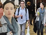 Makeup free: Olivia Wilde showed off her flawless skin with fiance Jason Sudeikis at the LAX airport