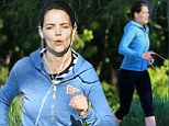 What holiday? Katie Holmes sticks to her strict workout regime as she fits in an early-morning jog on Florida break