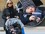 Jane Kraskowski's little man is as snug as a bug in rug as they venture out in chilly New York