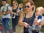 Baby love! Hilary Duff and husband Mike Comrie are very much the proud parents as they take little Luca for a day out