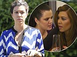 Big decision: Kourtney Kardashian, pictured in LA on Friday, is considering being a surrogate for her sister Khloe