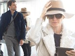 Ready for a rest? Make-up free Diane Kruger hides behind floppy hat and shades to board flight with boyfriend Joshua Jackson
