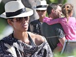 One happy trio! Halle Berry shows her affection on a Hawaiian vacation with fiancé Olivier Martinez and her daughter Nahla
