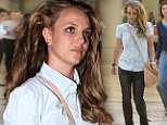Britney Spears arrived at Los Angeles International Airport on Thursday sporting smudged make-up and unkempt hair