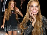 Lindsay Lohan looks healthy and happy as she works the red carpet in Sao Paulo... but keeps quiet over bracelet mystery