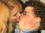 Going in for the kill: Brandi Glanville licks famous extra Jesse Heinman's lips as she attempt to recreate the kiss he shared with Bar Refaeli in the now famous Go Daddy commercial shown during this year's Super Bowl