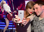 Look who's rocking! Taylor Swift shows off her provocative guitar playing at concert before greeting fans backstage