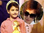 Just like mommy! Suri Cruise experiments with a new whispy mini bangs reminiscent of one of her mother's past hairstyles