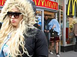 More bizarre behaviour: Amanda Bynes was spotted when she walked through Times Square this week in a kooky outfit. At one point she strolled around with a shirt on her head