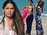 Idyllic: Camila sported a patterned maxi dress and adjusted her long dark brown hair in a break from being photographed