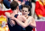 Alistair Brownlee and Jonathan Brownlee celebrate after winning Triathlon gold
