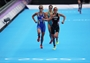 Lisa Norden of Sweden (L), Nicola Spirig of Switzerland (R), and Erin Densham of Australia finish the women's Triathlon