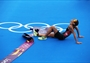 Nicola Spirig of Switzerland lays on the ground after winning the Triathlon