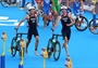 Alistair Brownlee and Jonathan Brownlee of Great Britain compete in Triathlon