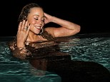 Mariah the mermaid! Carey dives into a pool wearing an elegant black fishtail gown whilst on Easter break with her family