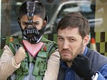 Bane buddies: Actor Tom Hardy poses Tuesday with a boy dressed as his evil character Bane from The Dark Knight Rises, the final film in the Batman trilogy by director Christopher Nolan
