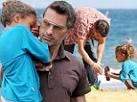 He's a natural at this! Doting Olivier Martinez enjoys playtime on the sand with Nahla before carrying sleepy girl home