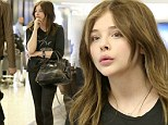 She's a tough cookie! Chloe Moretz travels to Los Angeles in Kick-Ass black leggings and rugged boots