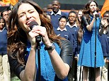 Blue belle Emmy Rossum helps swing a win for her home baseball team with a crowd-pleasing rendition of the national anthem