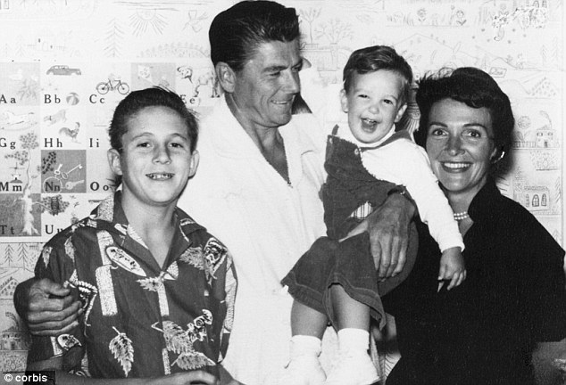 Son of a president: The Reagan family is pictured circa 1960. From left to right is Michael Reagan, Ronald Reagan, Ronald Reagan, Jr. and Nancy Reagan