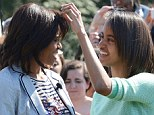 Straightening it out: It seemed to be Mrs Obama's bangs that were the problem