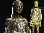 She is gold! Bizarre all-metallic look stuns the audience at Moscow Fashion Week... and the designer is from LONDON!