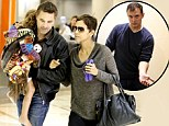 Halle Berry forced to step in as fiance Olivier Martinez 'assaults photographer during heated clash at the airport'