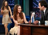 Holding court! Game of Thrones star Emilia Clarke shows off her lovely legs in yellow dress on Late Night with Jimmy Fallon