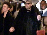 Holding hands: Earvin Johnson III holds his boyfriend's hand as they stroll down the Sunset Strip in LA this week