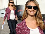 Sweeping the changes! Stacy Keibler is in cheerful mood as she launches TV career with Supermarket Superstar